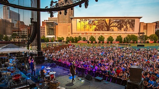 A large crowd at a concert in downtown Raleigh