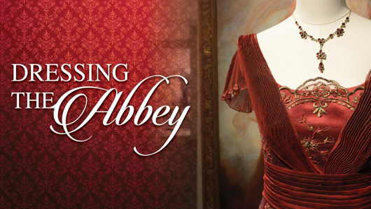 Dressing the Abbey exhibit graphic with a red dress adjacent