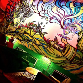 A colorful, flowing mural in Aunty Betty's Gin & Absinthe Bar