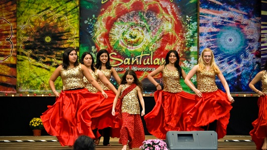 A group of women dancing on a stage at the Cary Diwali festival