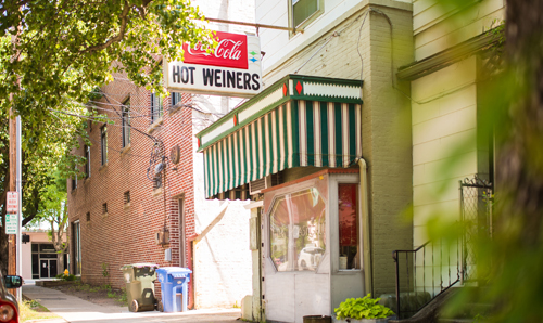 Exterior of The Roast Grill, with a vintage Coca-Cola and Hot Weiners sign