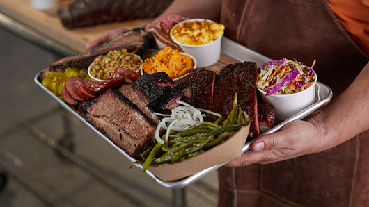 A platter of BBQ and sides