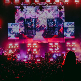 Photo of a big stage with a large crowd in front of it