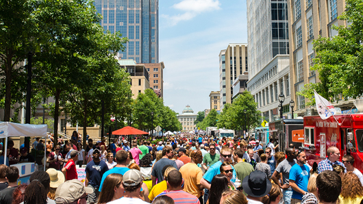 Large crowd at a festival on Fayetteville St. in downtown Raleigh