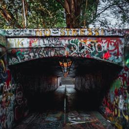 A tunnel covered in colorful grafitti