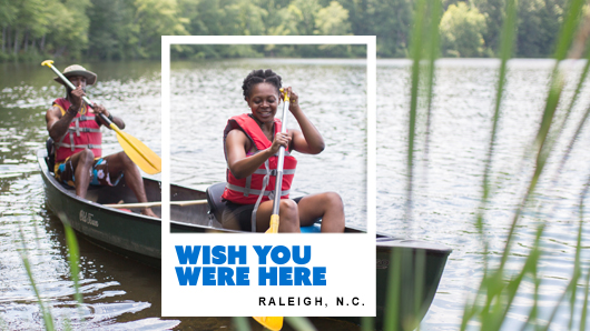 A couple boating on a lake at William B. Umstead State Park