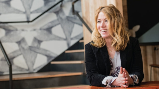 Coleen Speaks smiling in her restaurant Hummingbird