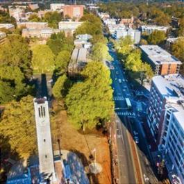 Aerial view of the The Memorial Belltower at North Carolina State University, plus Hillsborough St.
