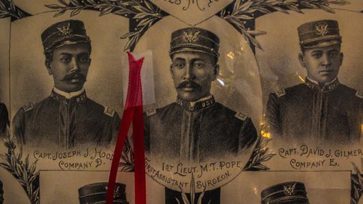 Close-up photo of a portrait of Dr. Manassa Thomas Pope