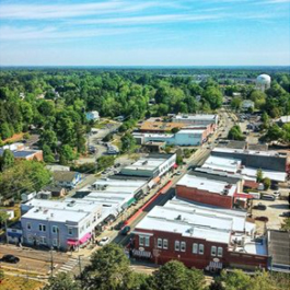 Aerial view of historic downtown Apex on a sunny summer day