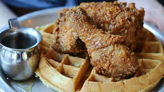 A delicious-looking plate of chicken and waffles with syrup
