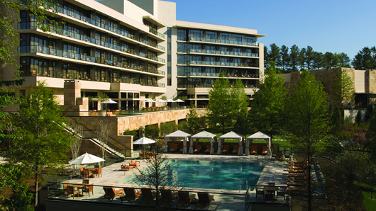 Back exterior of The Umstead Hotel, with the pool in the foreground